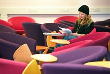 A student studying in a lounge area