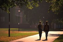 Students walking across campus in the dusk
