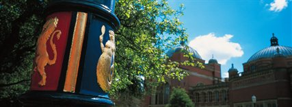 A detail photograph of a University lamp post featuring the mermaid and lion