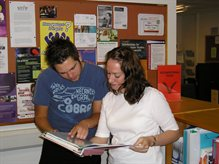 staff showing student resources in the information room
