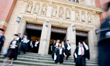 An image of graduate leaving through Aston Webb main doors