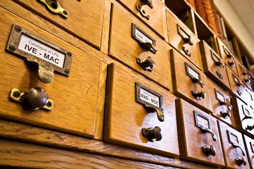 The card catalogue showing wooden drawers containing catalogue cards.
