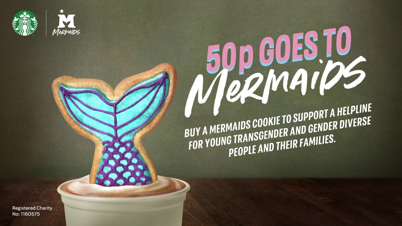 Mermaid tail cookie in a cup of coffee