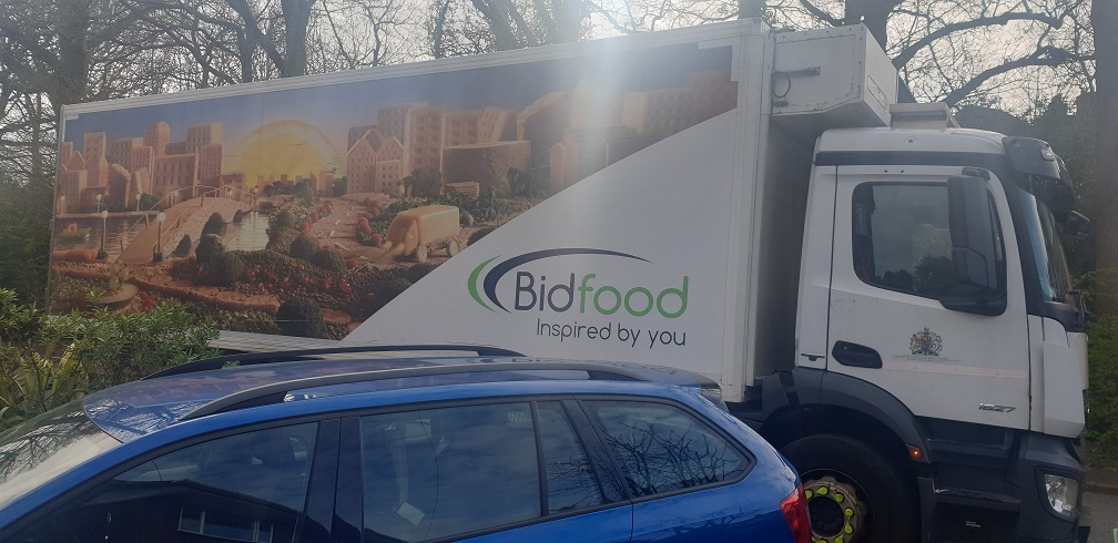 Bidfood lorry parked outside house