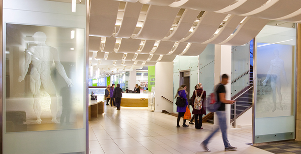 College of Medical and Dental Sciences foyer with the public walking past