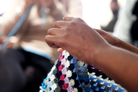 Close up of woman's hand with knitting